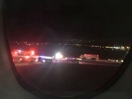 Emergency personnel are shown on the tarmac at Salt Lake City International Airport in this photograph taken by passenger Keith Rosso from a seat inside Air France flight 65, November 17, 2015. REUTERS/Keith Rosso/Handout via Reuters T