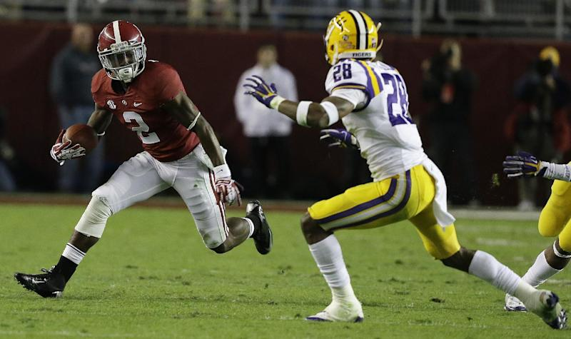 Alabama wide receiver DeAndrew White (2) runs against LSU cornerback Jalen Mills (28) during the first half of an NCAA college football game, Saturday, Nov. 9, 2013, in Tuscaloosa, Ala