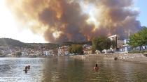 Flames burn on the mountain near Limni village on the island of Evia, about 160 kilometers (100 miles) north of Athens, Greece, Tuesday, Aug. 3, 2021. Greece Tuesday grappled with the worst heatwave in decades that strained the national power supply and fueled wildfires near Athens and elsewhere in southern Greece. As the heat wave scorching the eastern Mediterranean intensified, temperatures reached 42 degrees Celsius (107.6 Fahrenheit) in parts of the Greek capital. (AP Photo/Michael Pappas)