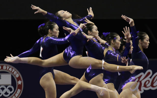 In this multiple exposure frame taken at one-fifth of a second intervals, Anna Li performs on the balance beam during the preliminary round of the women's Olympic gymnastics trials, Friday, June 29, 2012, in San Jose, Calif. (AP Photo/Julie Jacobson)