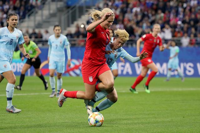 Lindsey Horan of the USA is challenged by Rattikan Thongsombut of Thailand inside the penalty area during the 2019 FIFA Women's World Cup France group F match between USA and Thailand at Stade Auguste Delaune on June 11, 2019 in Reims, France. (Photo by Robert Cianflone/Getty Images)
