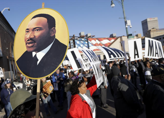 <p>People gather for events commemorating the 50th anniversary of the assassination of the Rev. Martin Luther King Jr. on Wednesday, April 4, 2018, in Memphis, Tenn. King was assassinated April 4, 1968, while in Memphis supporting striking sanitation workers. (Photo: Mark Humphrey/AP) </p>
