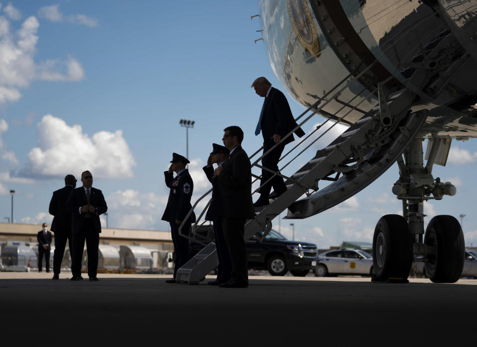 President Donald Trump departs Air Force One upon arrival in Cedar Rapids, Iowa, Tuesday, Aug. 18, 2020, to attend a disaster recovery briefing. (Doug Mills/The New York Times)