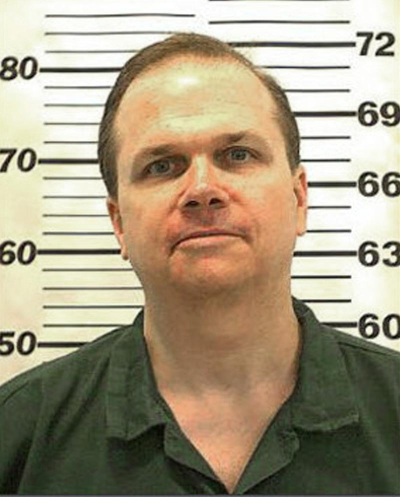This undated handout mugshot provided by the New York State Department of Corrections shows inmate Mark David Chapman