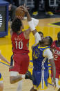 New Orleans Pelicans center Jaxson Hayes (10) is fouled by Golden State Warriors center Kevon Looney (5) during the first half of an NBA basketball game on Friday, May 14, 2021, in San Francisco. (AP Photo/Tony Avelar)