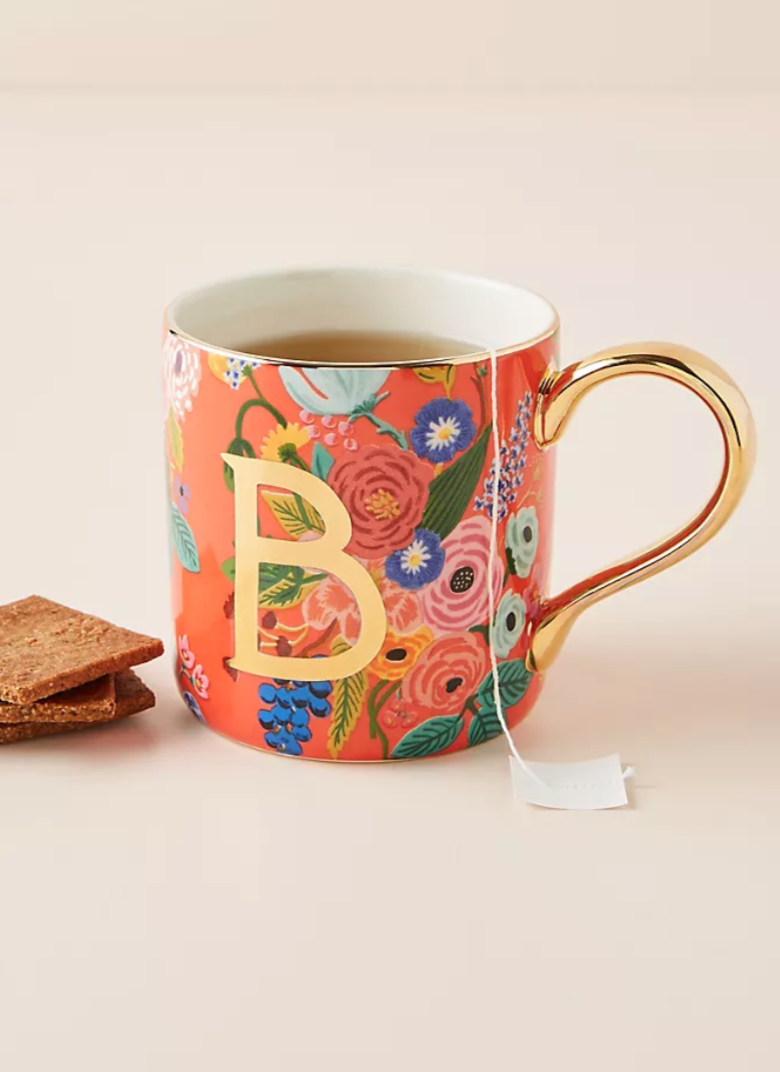 """<h3><a href=""""https://www.anthropologie.com/shop/rifle-paper-co-for-anthropologie-garden-party-monogram-mug"""" rel=""""nofollow noopener"""" target=""""_blank"""" data-ylk=""""slk:Anthropologie Garden Party Monogram Mug"""" class=""""link rapid-noclick-resp"""">Anthropologie Garden Party Monogram Mug</a></h3><br>What better way to feed her <a href=""""https://www.refinery29.com/en-us/2020/04/9684479/best-loose-leaf-tea"""" rel=""""nofollow noopener"""" target=""""_blank"""" data-ylk=""""slk:afternoon tea"""" class=""""link rapid-noclick-resp"""">afternoon tea</a> obsession than with a garden-inspired monogrammed mug? It's up to you whether you go with M (for mom, duh) or with the initial of her first name. <br><br><strong>Rifle Paper Co. x Anthropologie</strong> Garden Party Monogram Mug, $, available at <a href=""""https://go.skimresources.com/?id=30283X879131&url=https%3A%2F%2Fwww.anthropologie.com%2Fshop%2Frifle-paper-co-for-anthropologie-garden-party-monogram-mug"""" rel=""""nofollow noopener"""" target=""""_blank"""" data-ylk=""""slk:Anthropologie"""" class=""""link rapid-noclick-resp"""">Anthropologie</a>"""
