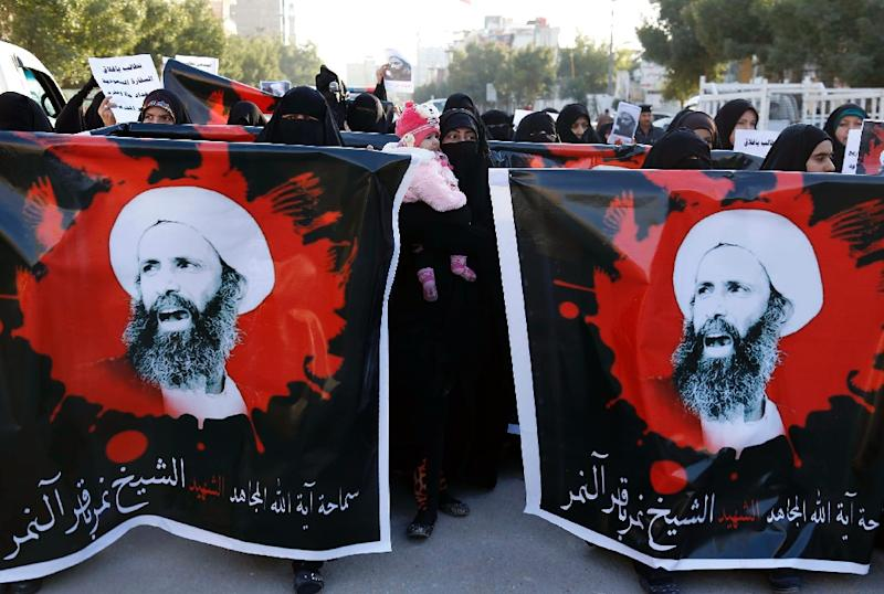 Iraqi women hold portraits of prominent Shiite cleric Nimr al-Nimr during a demonstration in Karbala as they protest against his execution by Saudi Arabian authorities