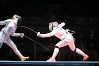 <p>Emese Szasz, (right), Hungary defeating Rossella Fiamingo, Italy, to win the gold medal during the Women's Épée Individual Final at Carioca Arena 3 on August 6, 2016 in Rio de Janeiro, Brazil. (Photo by Tim Clayton/Corbis via Getty Images) </p>
