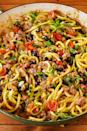 """<p>Zucchini stands up well to spices and sauteed veggies just as well as corn chips or tortillas. </p><p><em><a href=""""https://www.delish.com/cooking/recipe-ideas/a23067486/burrito-zoodles-recipe/"""" rel=""""nofollow noopener"""" target=""""_blank"""" data-ylk=""""slk:Get the recipe from Delish »"""" class=""""link rapid-noclick-resp"""">Get the recipe from Delish »</a></em></p>"""