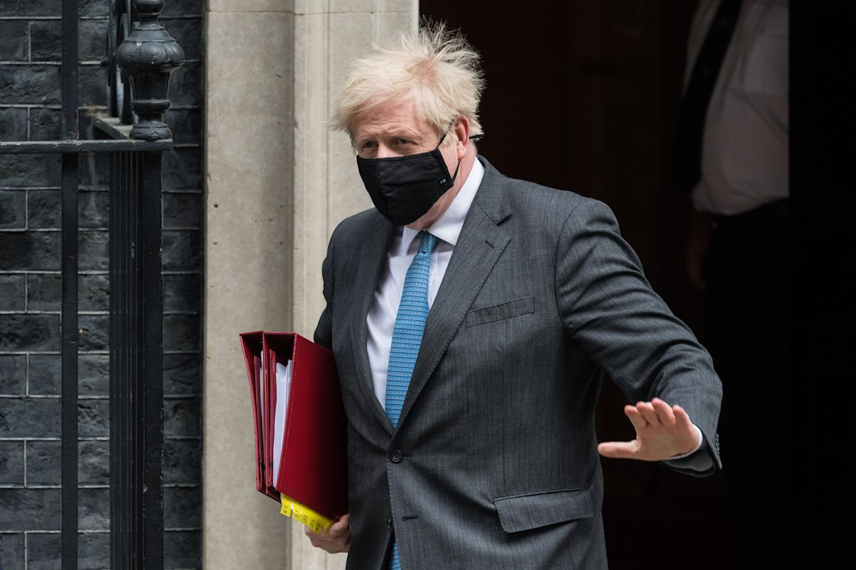LONDON, UNITED KINGDOM - APRIL 28, 2021: British Prime Minister Boris Johnson leaves 10 Downing Street for PMQs at the House of Commons, on 28 April, 2021 in London, England. (Photo credit should read Wiktor Szymanowicz/Barcroft Media via Getty Images)