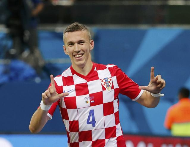 Croatia's Ivan Perisic celebrates scoring a goal against Cameroon during their 2014 World Cup Group A soccer match at the Amazonia arena in Manaus June 18, 2014. REUTERS/Yves Herman (BRAZIL - Tags: SOCCER SPORT WORLD CUP)
