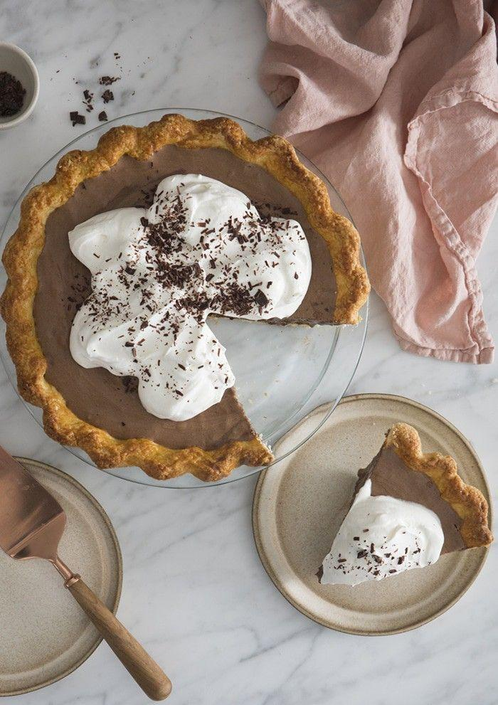 """<p>One bite into this silky <a href=""""https://www.countryliving.com/food-drinks/g957/chocolate-pie-recipes/"""" rel=""""nofollow noopener"""" target=""""_blank"""" data-ylk=""""slk:chocolate pie"""" class=""""link rapid-noclick-resp"""">chocolate pie</a> and you'll be hooked. It's impossible to eat a single slice.</p><p><strong>Get the recipe at <a href=""""https://preppykitchen.com/chocolate-silk-pie/"""" rel=""""nofollow noopener"""" target=""""_blank"""" data-ylk=""""slk:Preppy Kitchen"""" class=""""link rapid-noclick-resp"""">Preppy Kitchen</a>.</strong> </p>"""