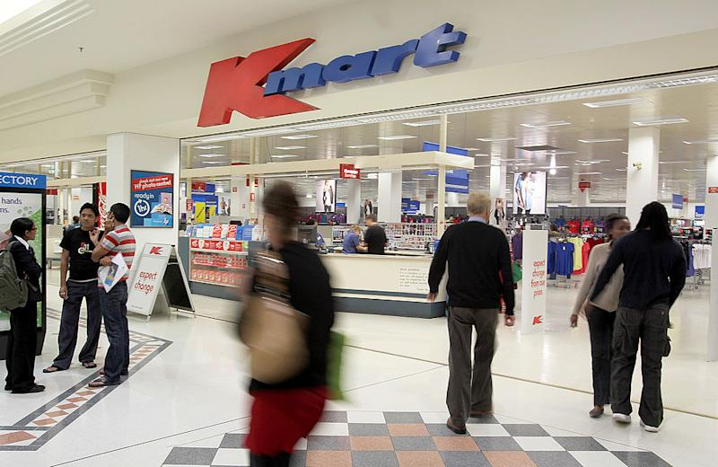 Shoppers in front of a Kmart Australia store front.