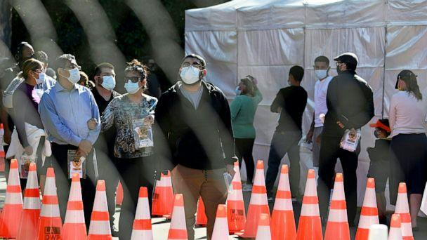 PHOTO: People wait in long lines for coronavius tests at a walk-up Covid-19 testing site in San Fernando, Calif., Nov. 24, 2020. (Robyn Beck/AFP via Getty Images, FILE)
