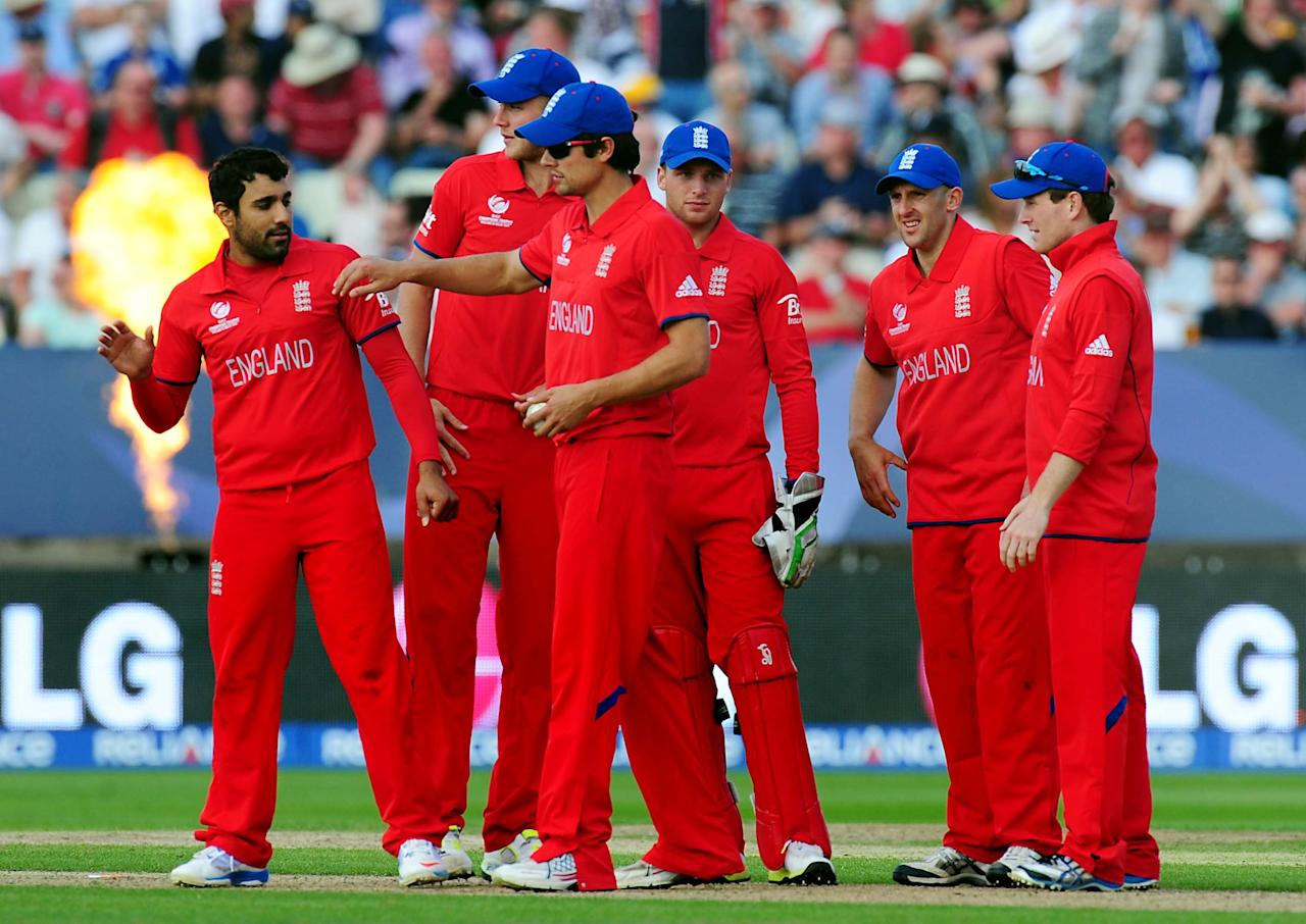 England's Ravi Bopara (left)celebrates Australia's Mitchell Johnson's wicket caught by Eoin Morgan during the ICC Champions Trophy match at Edgbaston, Birmingham.