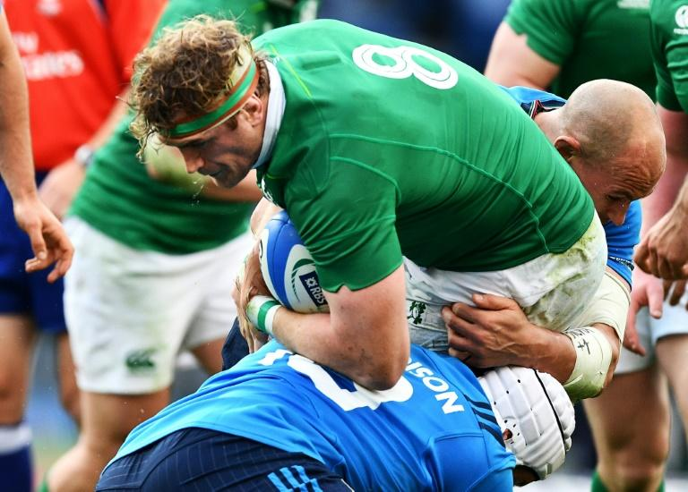 """Ireland's Jamie Heaslip (C) will be out for a number of weeks after undergoing a """"minor procedure"""" on his lower back"""