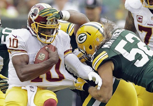 Washington Redskins quarterback Robert Griffin III (10) is sacked by Green Bay Packers outside linebacker Clay Matthews during the first half of an NFL football game Sunday, Sept. 15, 2013, in Green Bay, Wis. (AP Photo/Tom Lynn)