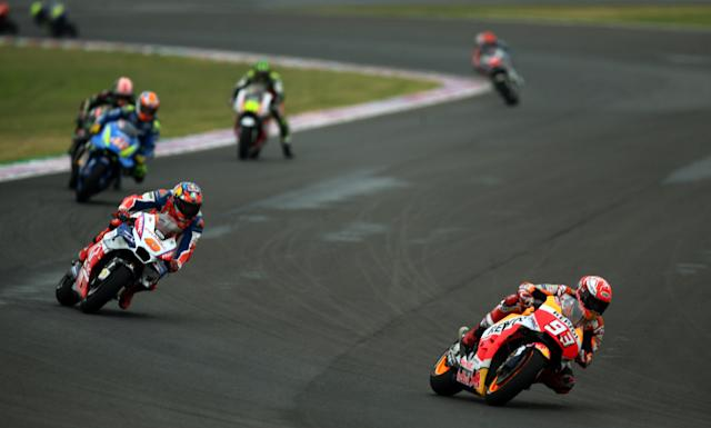 Motorcycle Racing - Argentina Motorcycle Grand Prix - MotoGP race - Termas de Rio Hondo, Argentina - April 8, 2018 - Repsol Honda Team rider Marc Marquez (93) of Spain and Alma Pramac Racing rider Jack Miller of Australia compete. REUTERS/Marcos Brindicci