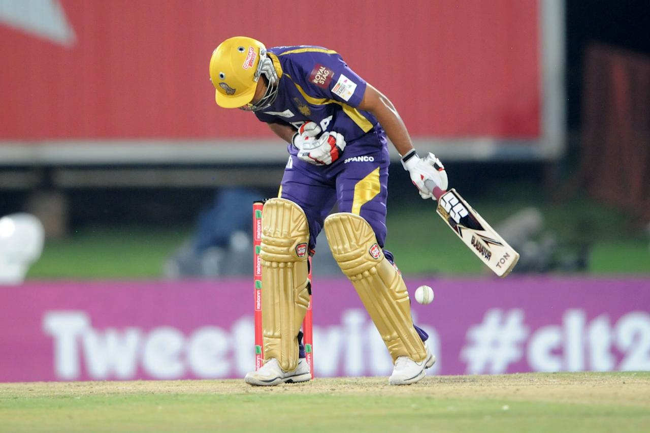 PRETORIA, SOUTH AFRCA - OCTOBER 13:  Rajat Bhatia of the Knight Riders reacts after being hit by a ball from Morne Morkelof the Daredevils during the Karbonn Smart CLT20 match between Kolkata Knight Riders (IPL) and Delhi Daredevils (IPL) at SuperSport Park on October 13, 2012 in Pretoria, South Africa.  (Photo by Lee Warren/Gallo Images/Getty Images)