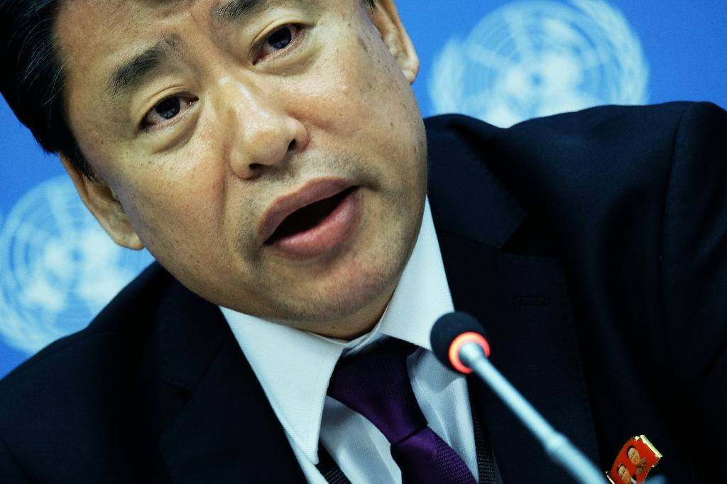 North Korea's deputy UN ambassador Kim In Ryong denies his government is behind cyberattacks while wearing a pin with images of North Korean leader Kim Jong-Un and his late father Kim Kim Jong-il, at the UN headquarters in New York on May 19, 2017. (AFP Photo/JEWEL SAMAD)