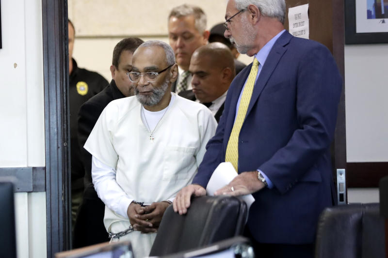 Abu-Ali Abdur'Rahman, front left, enters the courtroom for a hearing Wednesday, Aug. 28, 2019, in Nashville, Tenn. Abdur'Rahman, who was convicted of murder and is scheduled to be executed next April, claims that prosecutors' racially motivated dismissal of potential black jurors resulted in an unfair trial. (AP Photo/Mark Humphrey)