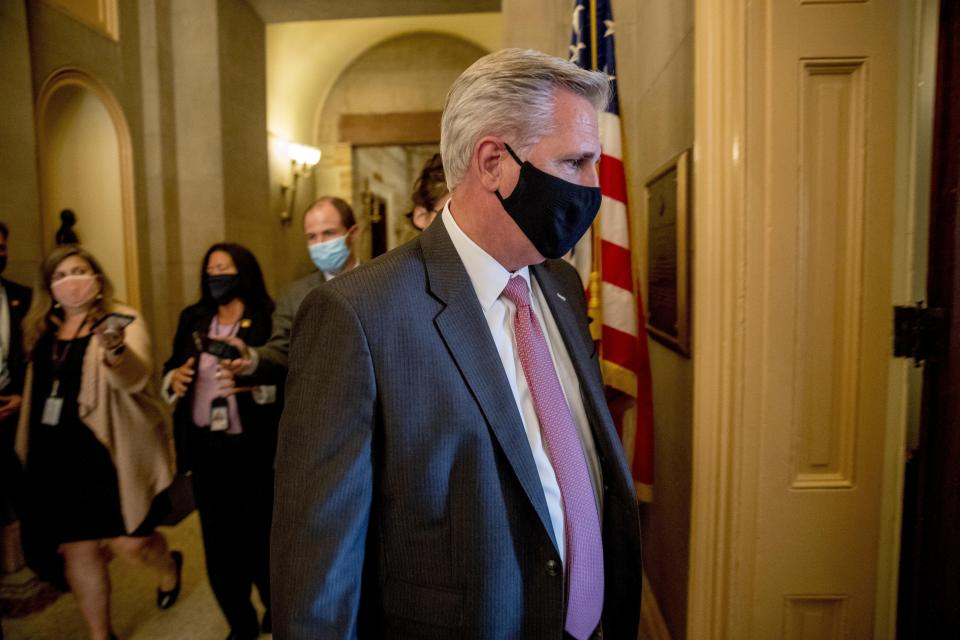 FILE - In this July 29, 2020, file photo House Minority Leader Kevin McCarthy of Calif., walks into a meeting with Republican lawmakers on Capitol Hill in Washington after lawmakers were unable to reach a deal on a new coronavirus relief package. Two years after a 40-seat surge fueled by wins in the suburbs hoisted Democrats to House control, Republican hopes of recapturing the majority have buckled along with President Donald Trump's approval ratings. Some worry that the party will lose seats, an agonizing letdown from their one-time dream of retaking control by gaining 17 seats. (AP Photo/Andrew Harnik, File)