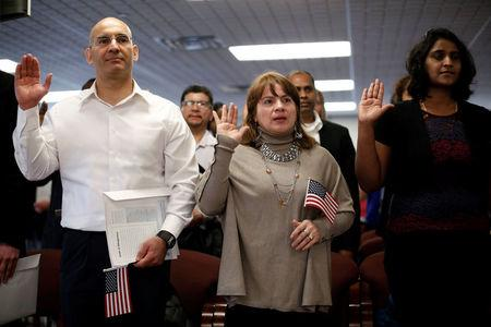 New American citizens take the Oath of Allegiance during a naturalization ceremony in Newark, New Jersey, U.S., March 1, 2017. REUTERS/Mike Segar