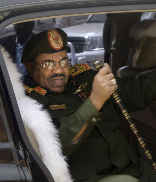 FILE: In this Thursday, April 22, 2010 file photo, Sudanese President Omar el-Bashir, in full military dress, gets out of his vehicle as he visits the military hospital, in Khartoum, Sudan. Sudan is calling on the United States to issue its president a visa as soon as possible to attend the U.N. General Assembly which opened yesterday, Monday, Sept. 17, 2013. The U.S. State Department said Washington has received Sudan's visa request, but that before presenting himself to the U.N. headquarters, El-Bashir should present himself to the International Criminal Court to answer for crimes linked to the conflict in Darfur. (AP Photo/Abd Raouf, File)