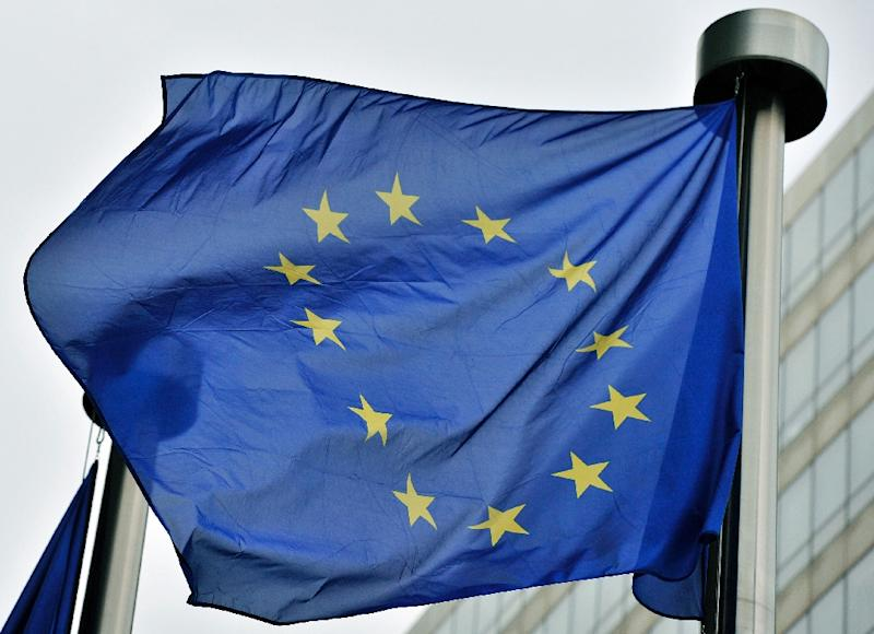 An European flag flies at the entrance of the EU Commission Berlaymont building in Brussels on May 21, 2014
