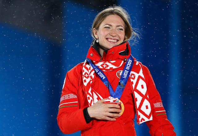 SOCHI, RUSSIA - FEBRUARY 18: Gold medalist Darya Domracheva of Belarus celebrates on the podium during the medal ceremony for the Women's 12.5 km Mass Start on day ten of the Sochi 2014 Winter Olympics at Medals Plaza on February 18, 2014 in Sochi, Russia. (Photo by Streeter Lecka/Getty Images)
