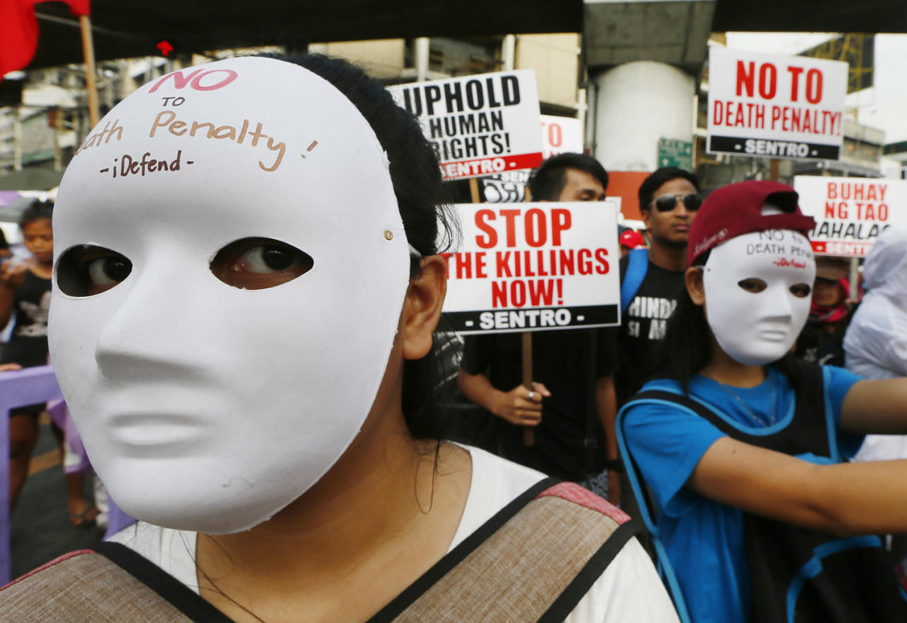 <p>Masked protesters display signs as they gather for a rally near the Presidential Palace to mark International Human Rights Day Saturday, Dec. 10, 2016, in Manila, Philippines. The protesters are calling for an end to extra-judicial killings by the government. (Bullit Marquez/AP) </p>