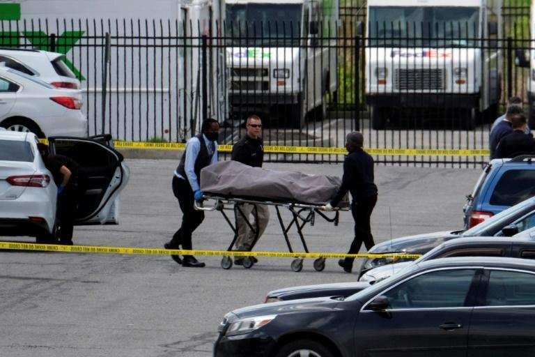 Officials recover a body at the site of a mass shooting at a FedEx facility in the US city of Indianapolis, Indiana, on April 16, 2021, after a former company employee killed eight people before committing suicide