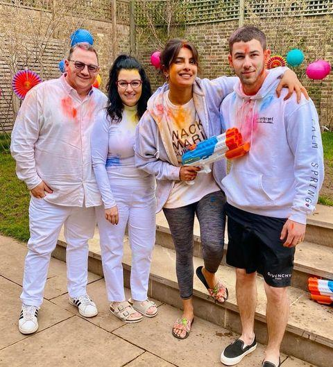 """<p>Nick Jonas and Priyanka Chopra Jonas recently celebrated Holi in style.</p><p>The couple both took to their Instagram accounts on Sunday (March 28) to share photos of themselves donning paint splattered white attire, while celebrating the ancient Hindu festival, with the singer's parents Kevin Sr. and Denise Jonas.</p><p>The holiday is also known as the 'festival of colours' and is a celebration of the eternal and divine love of the goddess Radha and god Krishna. It also signifies the triumph of good over evil.</p><p>'Happy Holi! From our family to yours! #holi, [sic]' Jonas captioned the photo of his family. </p><p>Chopra-Jonas shared the same photos from the occasion, captioning hers: 'Holi, the festival of colours is one of my favourites. Hope we can all celebrate it with our loved ones, but in our HOMES! #HappyHoli everyone [sic]'. </p><p><a href=""""https://www.instagram.com/p/CM-XYmCjVBn/"""" rel=""""nofollow noopener"""" target=""""_blank"""" data-ylk=""""slk:See the original post on Instagram"""" class=""""link rapid-noclick-resp"""">See the original post on Instagram</a></p>"""