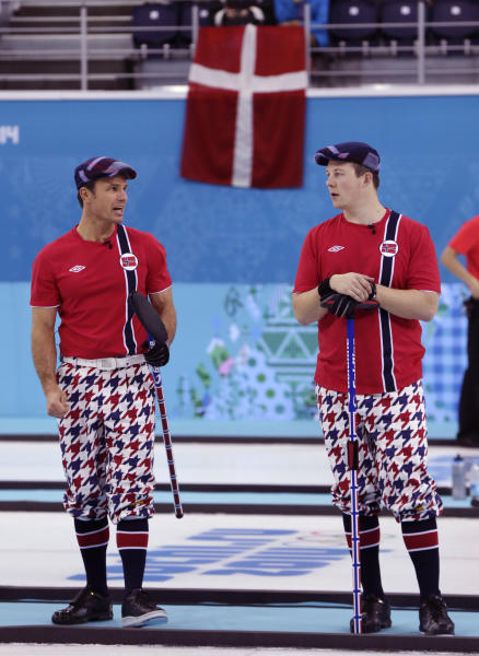 Norway's skip Thomas Ulsrud, left, and Christoffer Svae talk strategy during men's curling competition against Germany at the 2014 Winter Olympics, Wednesday, Feb. 12, 2014, in Sochi, Russia. (AP Photo/Robert F. Bukaty)