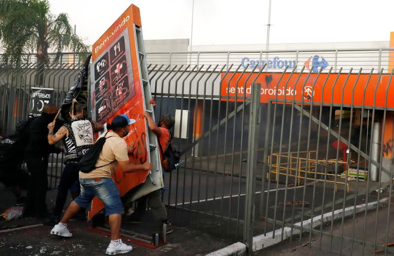 Demonstrators vandalize a Carrefour store during a protest against racism, after Joao Alberto Silveira Freitas was beaten to death by security guards at a Carrefour supermarket in Porto Alegre