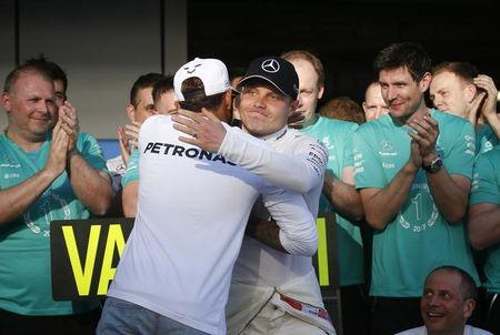 Formula One - F1 - Russian Grand Prix - Sochi, Russia - 30/04/17 - Drivers of Mercedes Formula One team Valtteri Bottas (R) of Finland and Lewis Hamilton of Britain greet each other after the race. REUTERS/Maxim Shemetov