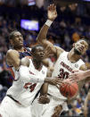South Carolina forward Keyshawn Bryant (24) and Chris Silva (30) keep Auburn forward Horace Spencer, left, from the ball in the first half of an NCAA college basketball game at the Southeastern Conference tournament Friday, March 15, 2019, in Nashville, Tenn. (AP Photo/Mark Humphrey)
