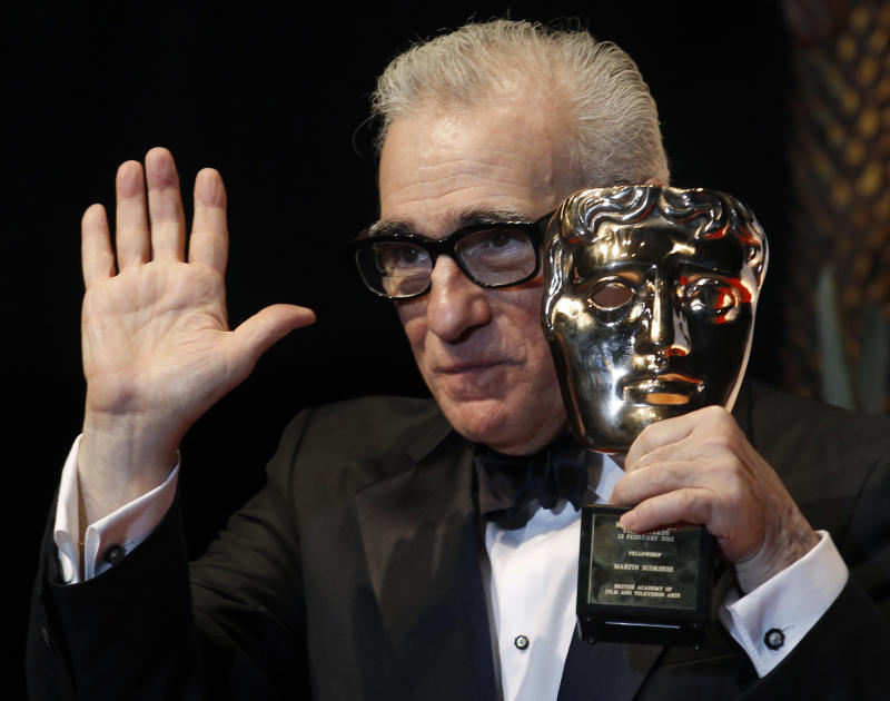 Director Martin Scorsese celebrates with his fellowship award at the British Academy of Film and Arts (BAFTA) awards ceremony at the Royal Opera House in London February 12, 2012. REUTERS/Suzanne Plunkett (BRITAIN - Tags: ENTERTAINMENT) (BAFTA-WINNERS)