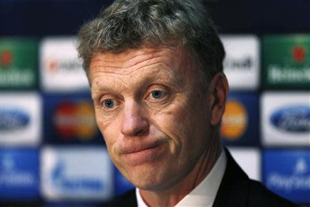 Then Manchester United's manager David Moyes listens to a question during a news conference at Old Trafford in Manchester, northern England in this March 18, 2014 file photo. REUTERS/Phil Noble/Files