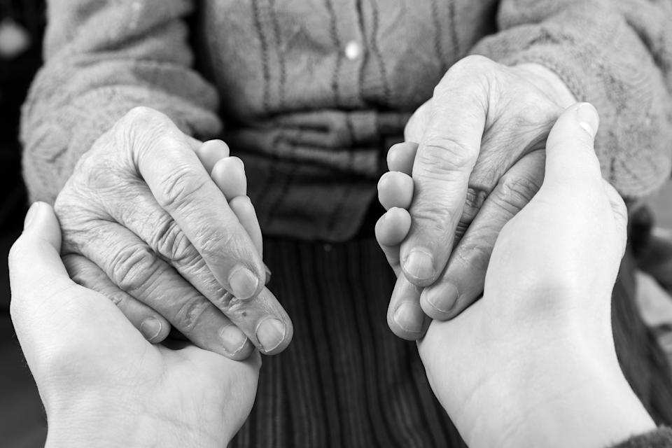 Young carer giving helping hands for elderly woman (Photo: Obencem via Getty Images/iStockphoto)