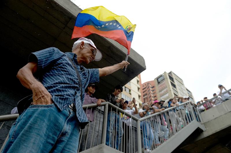 Opposition activists protest against the government in Caracas on May 12, 2017