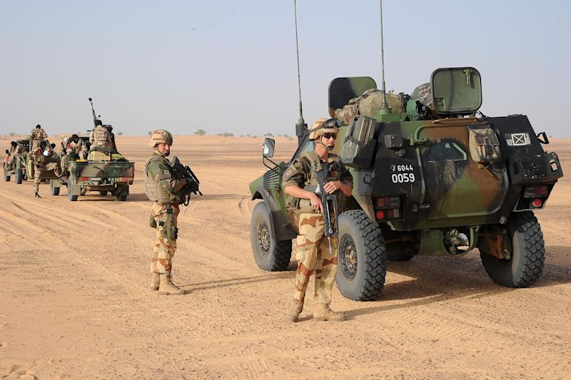 French soldiers take position outside Bourem, northern Mali, Sunday, Feb. 17, 2013. Mali's military detained eight Arab men last week in Timbuktu, raising fears of further reprisals against the region's Arab minority whose members are accused of having supported the al-Qaida-linked groups which overran northern Mali last year. (AP Photo /Pascal Guyot, Pool)