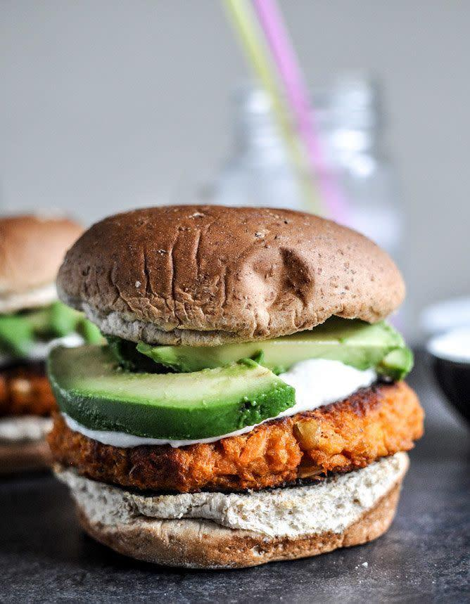 """<strong>Get the <a href=""""https://www.howsweeteats.com/2012/09/smoky-sweet-potato-burgers-with-roasted-garlic-cream-and-avocado/"""" rel=""""nofollow noopener"""" target=""""_blank"""" data-ylk=""""slk:Smoky Sweet Potato Burgers with Roasted Garlic Cream and Avocado recipe"""" class=""""link rapid-noclick-resp"""">Smoky Sweet Potato Burgers with Roasted Garlic Cream and Avocado recipe</a> from How Sweet It Is</strong>"""