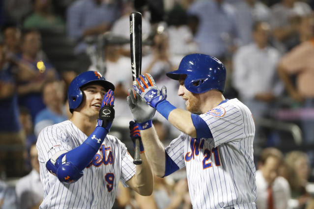 New York Mets' Brandon Nimmo (9) and Todd Frazier (21) celebrate at the plate after Frazier's solo home run during the third inning of the team's baseball game against the Arizona Diamondbacks, Wednesday, Sept. 11, 2019, in New York. (AP Photo/Kathy Willens)