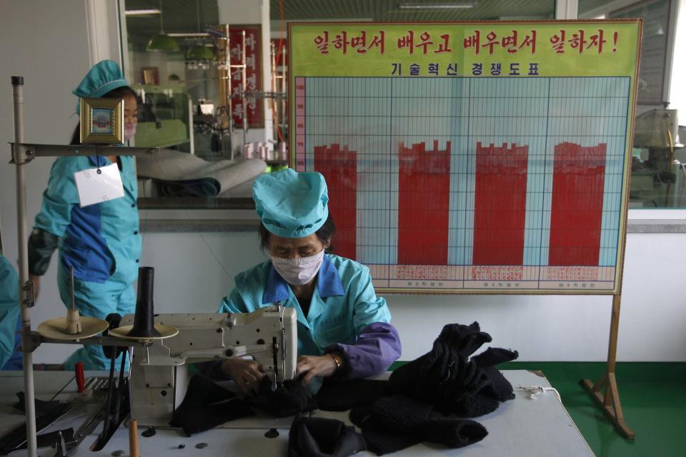 Workers wearing face masks at the Wonsan Leather Shoes Factory, where they manufacture handmade leather shoes in Wonsan, Kangwon Province, North Korea DPRK, on Wednesday, Oct., 28, 2020. (AP Photo/Jon Chol Jin)