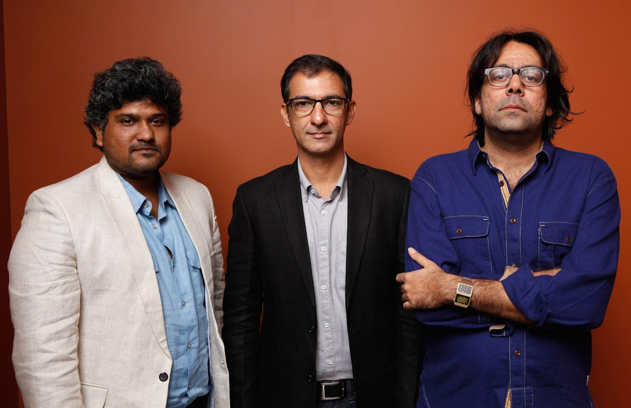"TORONTO, ON - SEPTEMBER 11:  (L-R) Directors Vasan Bala, Habib Faisal and Ashim Ahluwalia of ""City To City"" pose at the Guess Portrait Studio during 2012 Toronto International Film Festival on September 11, 2012 in Toronto, Canada.  (Photo by Matt Carr/Getty Images)"