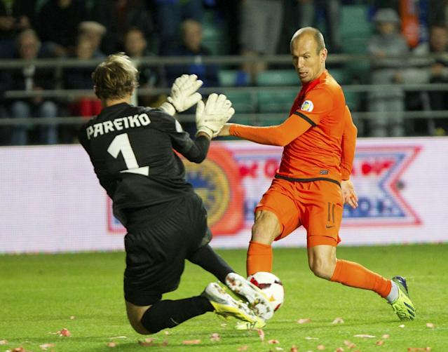 FILE - In this Sept. 6, 2013, file photo, Netherland's Arjen Robben, right, shoots the ball during their World Cup group D qualifying soccer match in Tallinn, Estonia. (AP Photo/Liis Treimann, File)