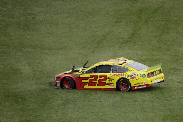 Joey Logano drives across the grass after losing control during a NASCAR Cup Series auto race at Kansas Speedway in Kansas City, Kan. Sunday, Oct. 20, 2019. (AP Photo/Charlie Riedel)