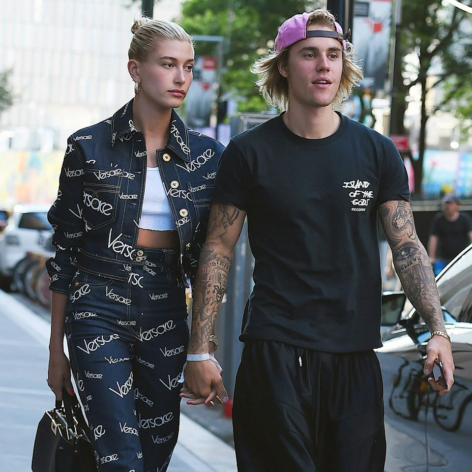 "<a href=""https://www.allure.com/story/justin-bieber-haircut-with-hailey-baldwin?mbid=synd_yahoo_rss"">Justin Bieber and Hailey Baldwin</a> have rocked numerous coordinating outfits that are perfect for Halloween. Might I suggest one of their more memorable fashion moments together, like <a href=""https://www.vogue.com/article/hailey-baldwin-justin-bieber-new-york-city-versace?mbid=synd_yahoo_rss"">the one that included Versace and hotel slippers</a>? To re-create Hailey's look, paint the word ""Versace"" on a matching denim outfit while your boo wears baggy athletic shorts, black tube socks, and a pair of cozy white slippers."