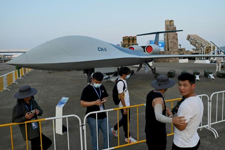 A prototype of a new surveillance drone able to carry out attacks -- the CH-6 -- was among domestic tech unveiled in Zhuhai (AFP/Noel Celis)